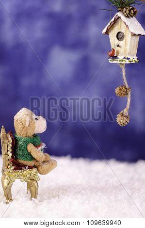 Plush Monkey On A Chair Looking Decorative Birdhouse.