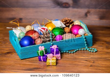 Composition Of Vintage Wooden Box With Christmas Decoration, Tinsel,  Pinecones, Stars, Balls And Gi