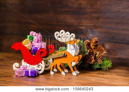 Composition Of Christmas Decoration  Reindeer And Santa Sleigh With Gifts, Branch Fir Tree, Pinecone