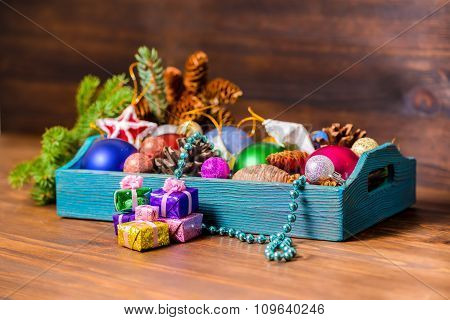 Branch Of Fir Tree And Vintage Wooden Box With Christmas Decoration, Tinsel,  Pinecones, Stars, Ball