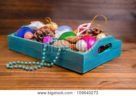Composition Of Retro Wooden Box With Christmas Decoration, Tinsel,  Pinecones, Stars, Balls And Bead
