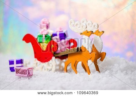 Christmas Decoration Reindeer And Santa Sleigh With Gifts In Snow On North Polar Light Background, C