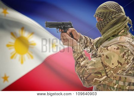 Male In Muslim Keffiyeh With Gun In Hand And National Flag On Background - Philippines