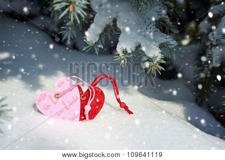 two heart at snow on fir tree, winter landscape valentine concept