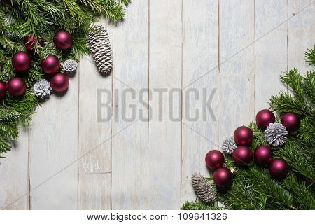 Card Concept Fir, Christmas Balls And Cones On Wooden Background