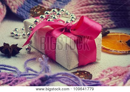 Christmas gift box, bijouterie and winter scarf