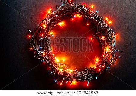 Circle from a christmas lamp garland.