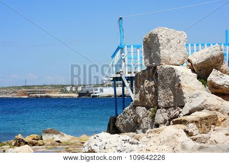 Old port on the Rocks with the sea