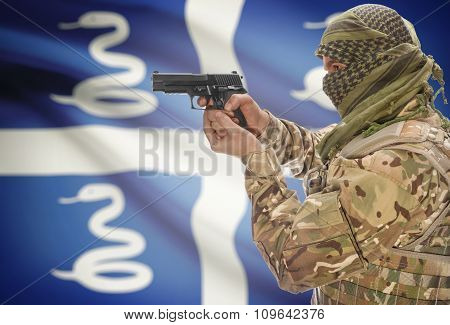 Male In Muslim Keffiyeh With Gun In Hand And National Flag On Background - Martinique