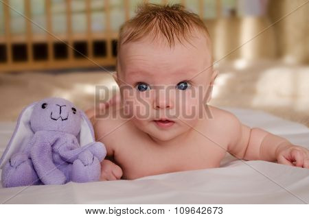 Naked Baby With A Toy