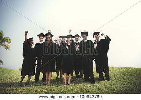 Group Students Hands Raised Graduation Concept
