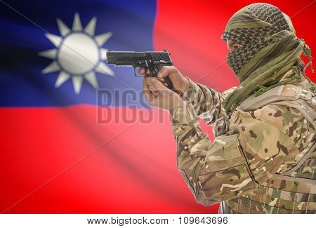 Male In Muslim Keffiyeh With Gun In Hand And National Flag On Background - Taiwan