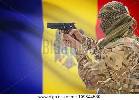 Male In Muslim Keffiyeh With Gun In Hand And National Flag On Background - Moldova