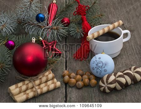 Coniferous Branch With Christmas Tree Decorations, Coffee, Nutlets And Baking