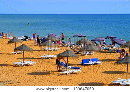 Families enjoying the sun on Albufeira Beach