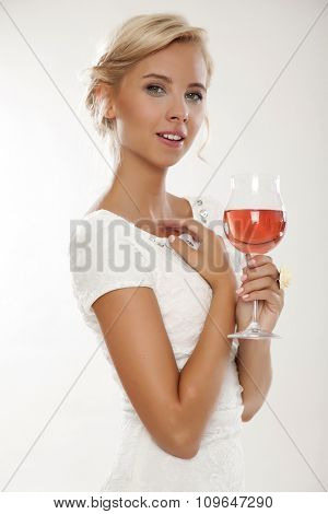 Close up portrait of happy smiling beauty young adult attractive sexy and sensuality pretty blonde woman with glass of red rose wine, in white dress isolated on white background