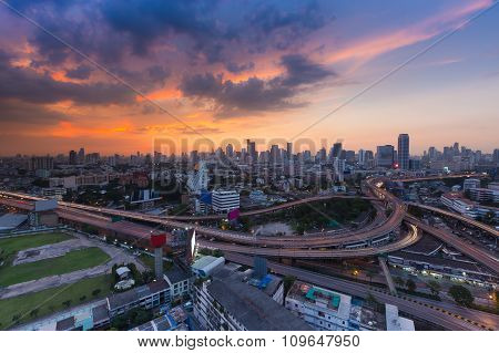 Aerial view Bangkok city background and highway intersection with beautiful sky