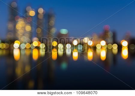 Abstract blurred city lights background with water reflection