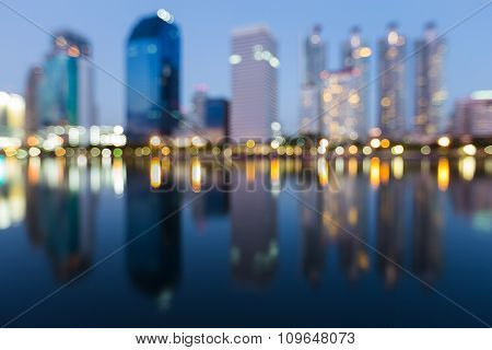 Abstract blurred bokeh background city lights with water reflection