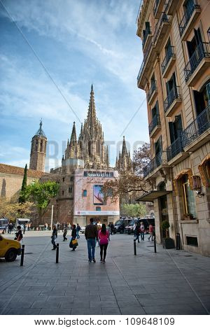 BARCELONA, SPAIN - MAY 03: Bustling City Street with Pedestrians and View of Gothic Spires of Historic Barcelona Cathedral and Museu Diocesa with Gaudi Exhibit, Barcelona, Spain. May 03, 2015.