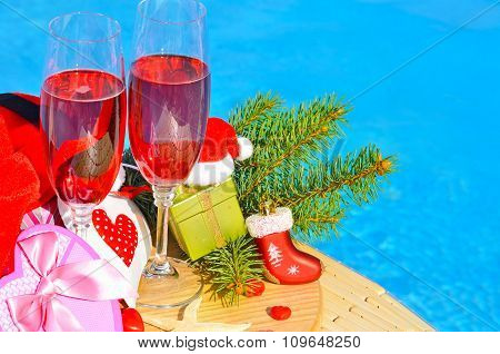 Glasses With Red Champagne  And Christmas Decor
