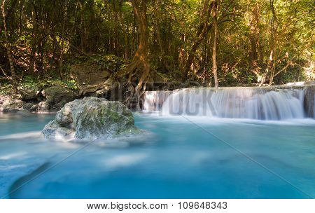 Deep forest blue stream waterfalls in national park of Thailand