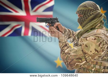 Male With Gun In Hand And National Flag On Background - Tuvalu
