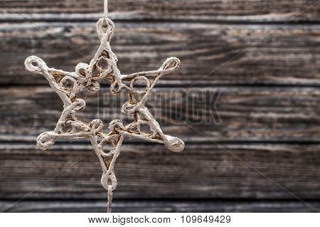 Handmade Star Figurine On Wooden Background