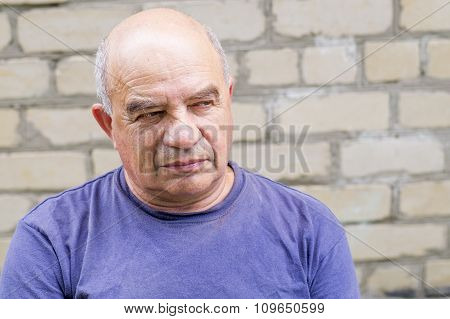 Old Man Looking For Someone With Contempt