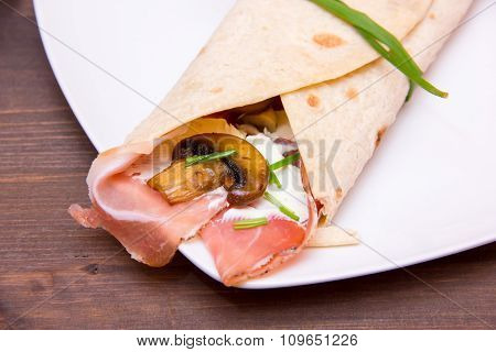 Flatbread with bacon and mushrooms on wood close