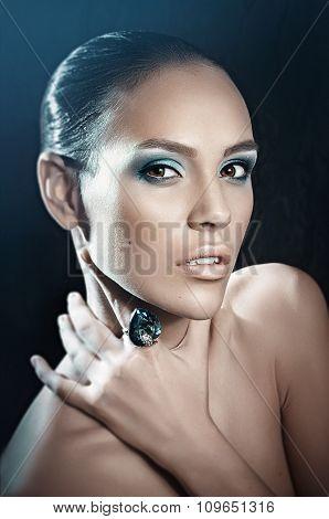 Beautiful girl with makeup in luxury jewelry