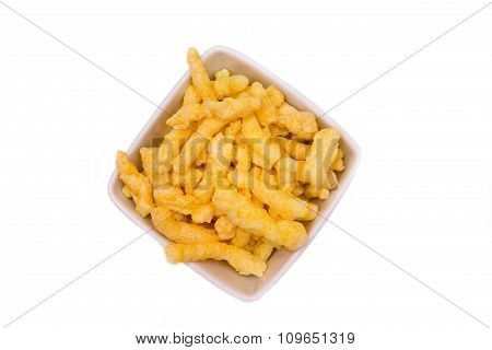 Snack corn cheese in square bowl from above