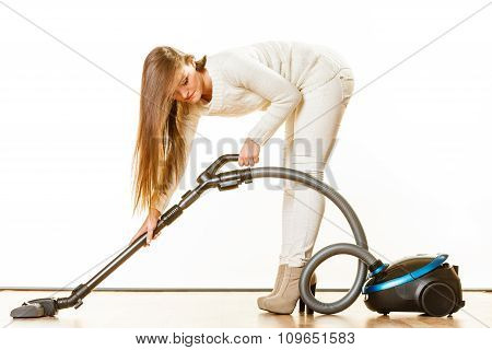 Woman With Vacuum Cleaner.