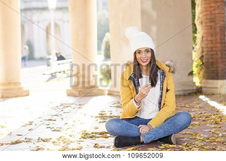 Happiness Woman With Hat And Phone, Sitting On Leaves Autumn.