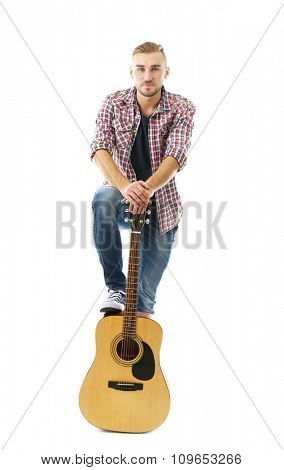 Young musician with guitar isolated on white
