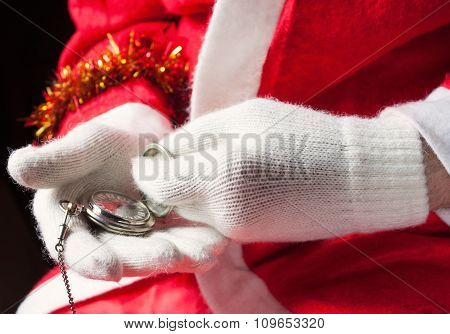 Santa Claus holding a pocket watch