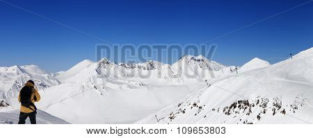 Snowboarder And Panoramic View On Ski Resort