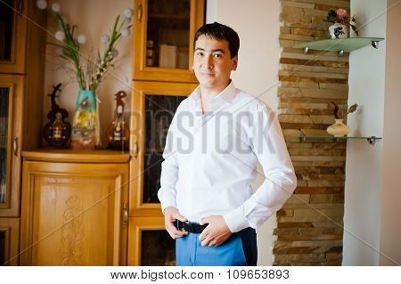 Groom  Gets Dressed In Formal Wear And Blue Suit