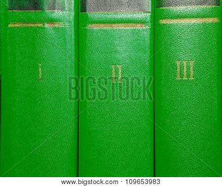 Volumes Of Old Books With Gold Lettering On The Cover