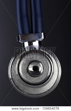 Stethoscope close-up on dark background