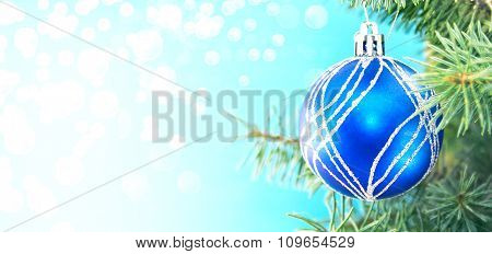 Blue Christmas Ball And Green Tree On Shiny Background With Copy Space For Text. Christmas Backgroun