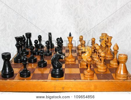 Chessboard With Wooden Figures.