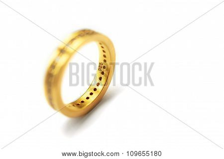 Golden Ring Isolated On White Background. Selective Focus.