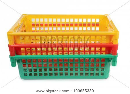 Colorful plastic basket on white background