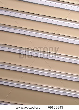 Silver and beige slat background angled right down