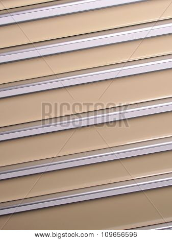Silver and beige slat background angled right up
