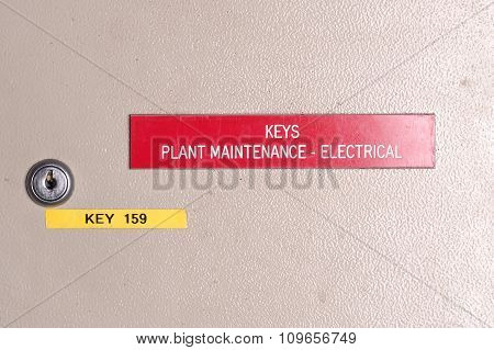 Industrial wall mounted key box lock and engraved sign