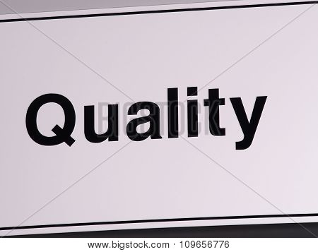 Quality wall sign in black on off white background
