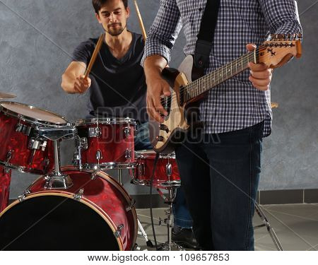 Musicians playing the drums in a studio