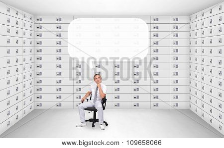 Businessman Sitting In Security Safe Room